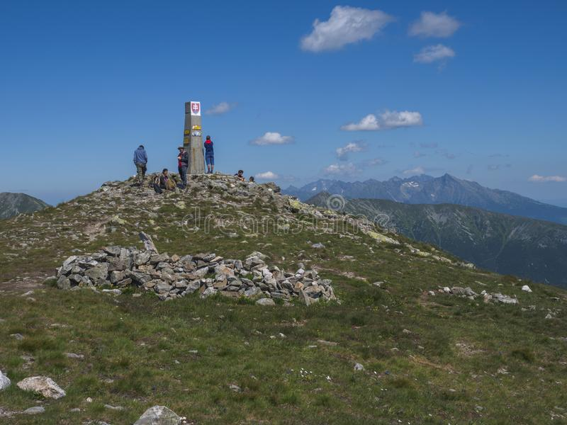 Slovakia, Western Tatra mountain, July 4, 2019: group of hiker people resting on top of Baranec peak in Western Tatra royalty free stock images