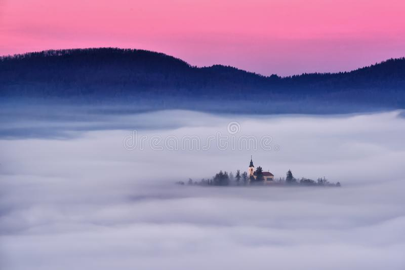 Slovenia beautiful landscape with mist and church in the morning royalty free stock images