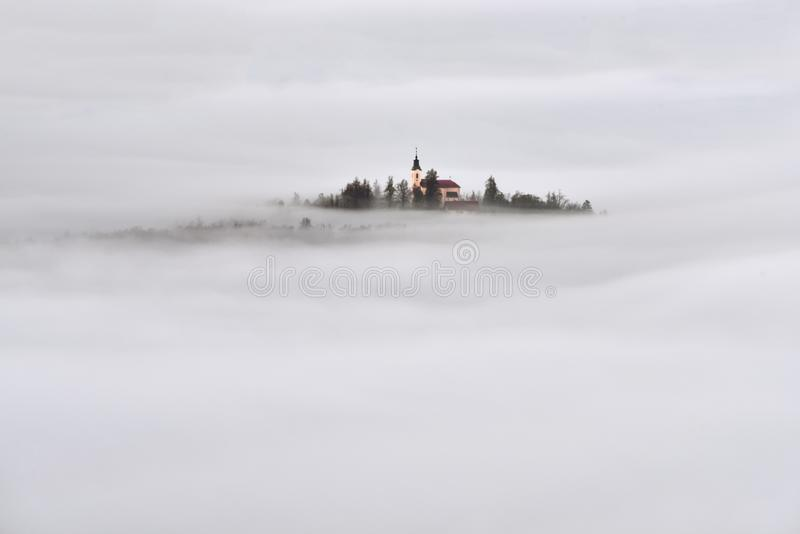 Slovenia beautiful landscape with mist and church in the morning royalty free stock photos