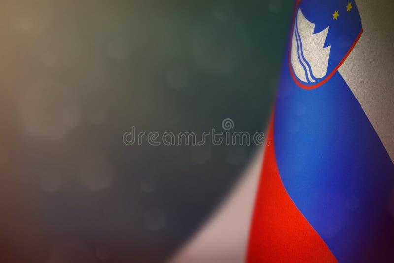 Slovenia flag for honour of veterans day or memorial day. Glory to the Slovenia heroes of war concept on red dark velvet. Slovenia hanging flag for honour of stock photos
