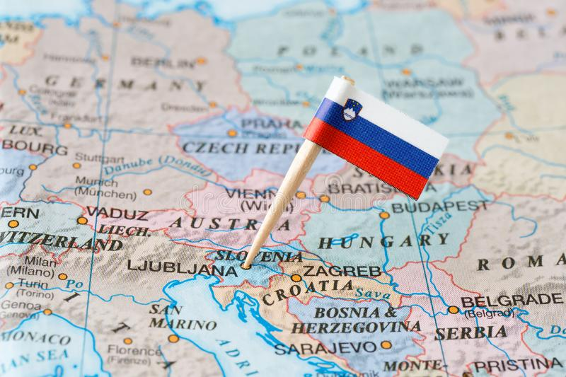 Slovenia map and flag pin royalty free stock images