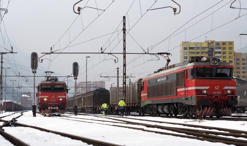 JESENICE, SLOVENIA - MARCH 2 2018: Slovenian Railways Class 363`s ready to depart on a wintery day. Slovenia Railways Calss 363 Electric Locomotives in Jesenice stock image
