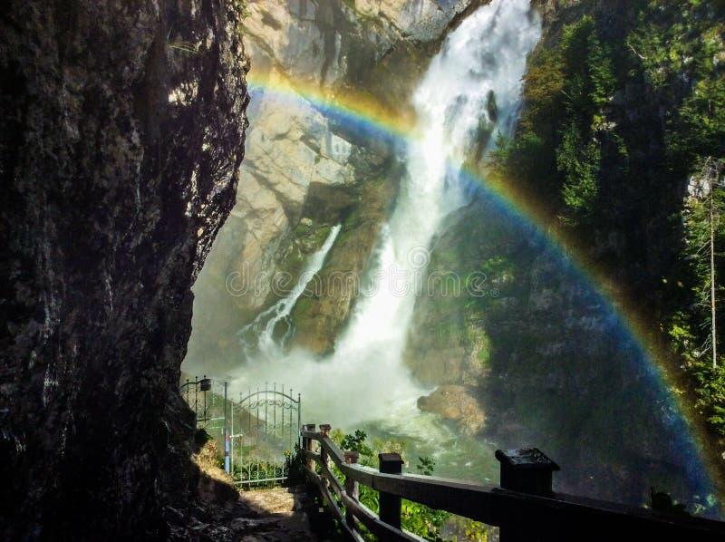 Slovenia's rainbow with a waterfall. stock image