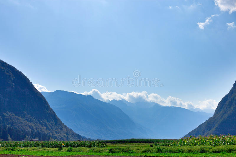 Slovenian mountain peaks and green valley. Slovenia Alpine mountains and green valley royalty free stock images