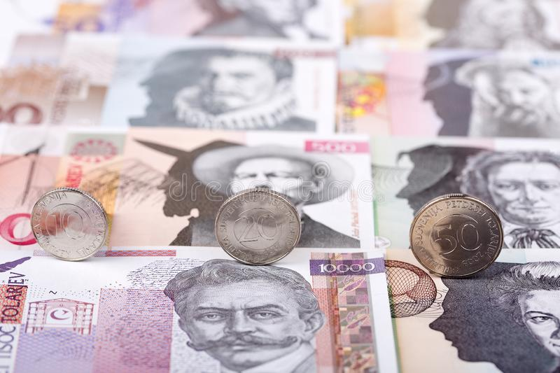 Slovenian tolar coins. On the background of banknotes stock image