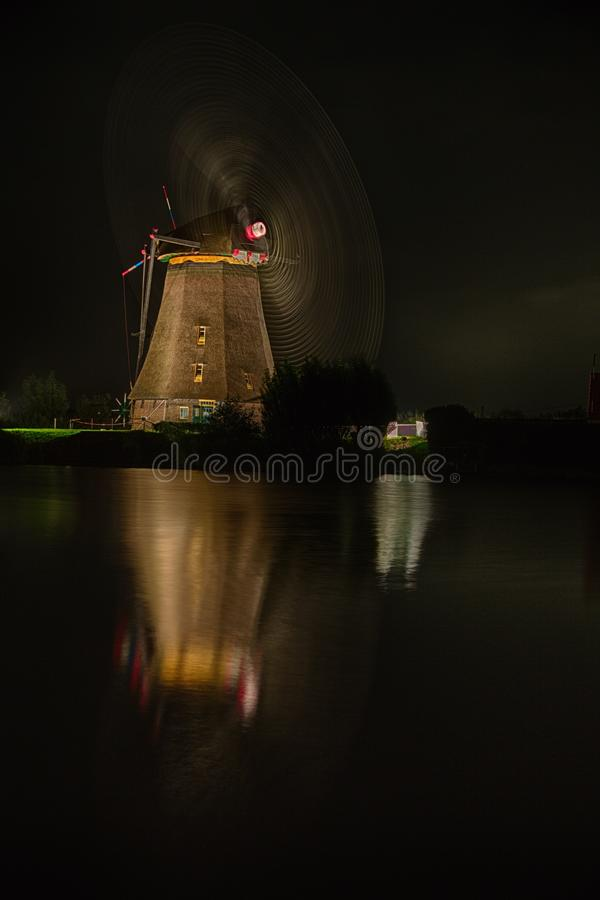 Free Slow Capture Of A Windmill In Motion At Night Royalty Free Stock Images - 104138209
