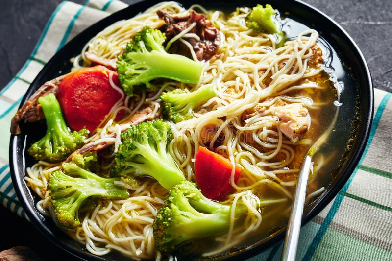 Slow cooked chicken noodle soup, top view stock photography