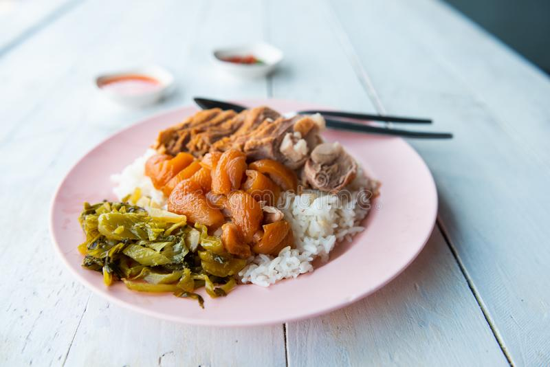 Slow cooked pork leg with steamed rice. Street food of thailand stock photography