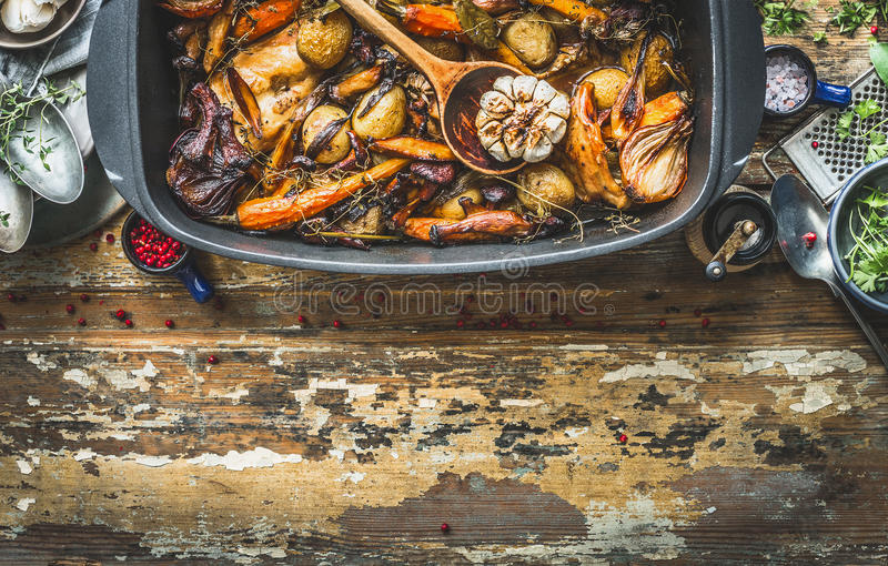 Slow cooked rabbit stew with forest mushrooms and garden vegetables of season. Rabbit ragout on rustic kitchen table with cooking. Ingredients and tools, top royalty free stock photography