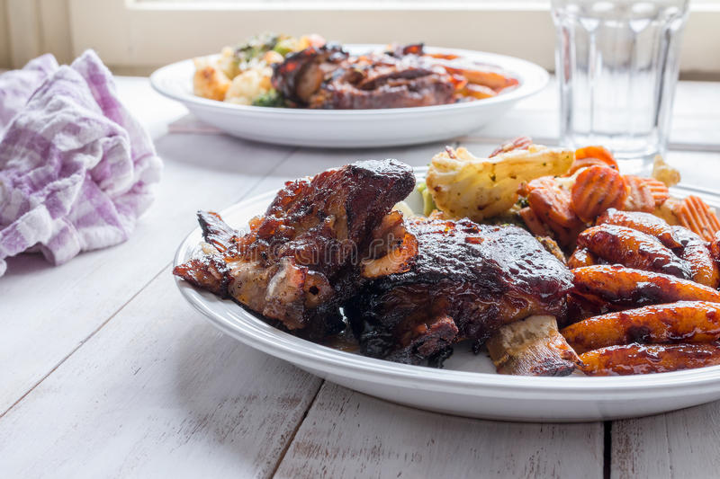 Slow cooked ribs with homemade pasta and grilled vegetables royalty free stock image
