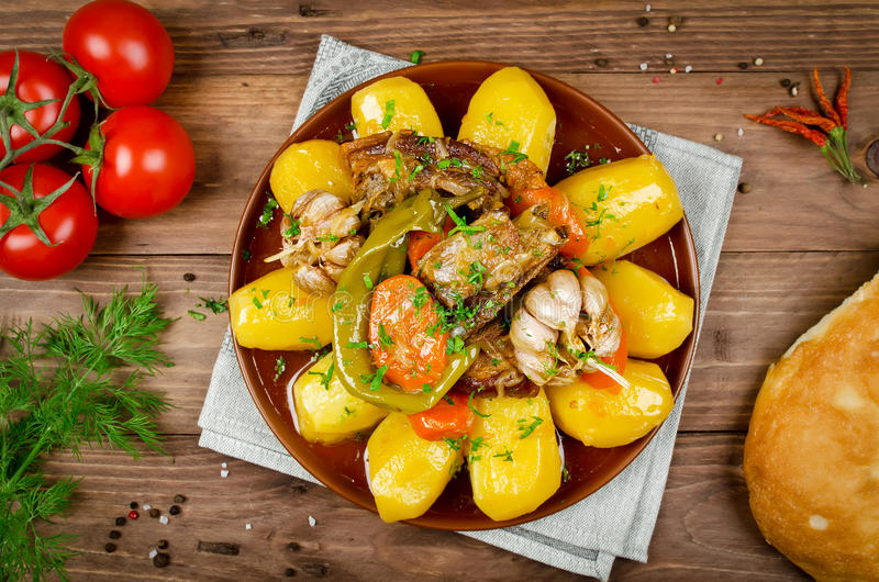 Slow-cooked stew with tender lamb meat, potatoes and vegetables stock image
