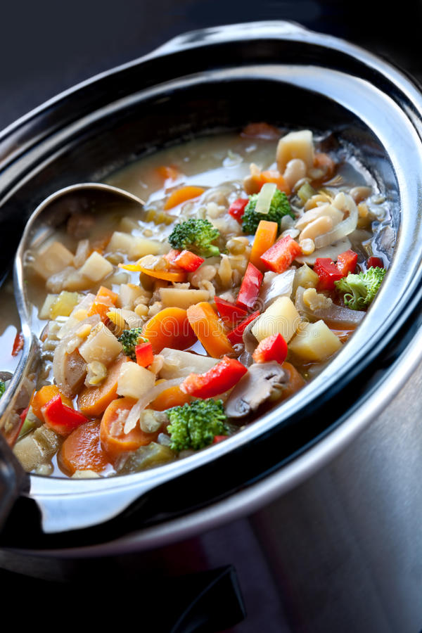 Slow-Cooked Vegetable Soup. Vegetable soup, slow-cooked in a crock pot, ready to serve royalty free stock photos