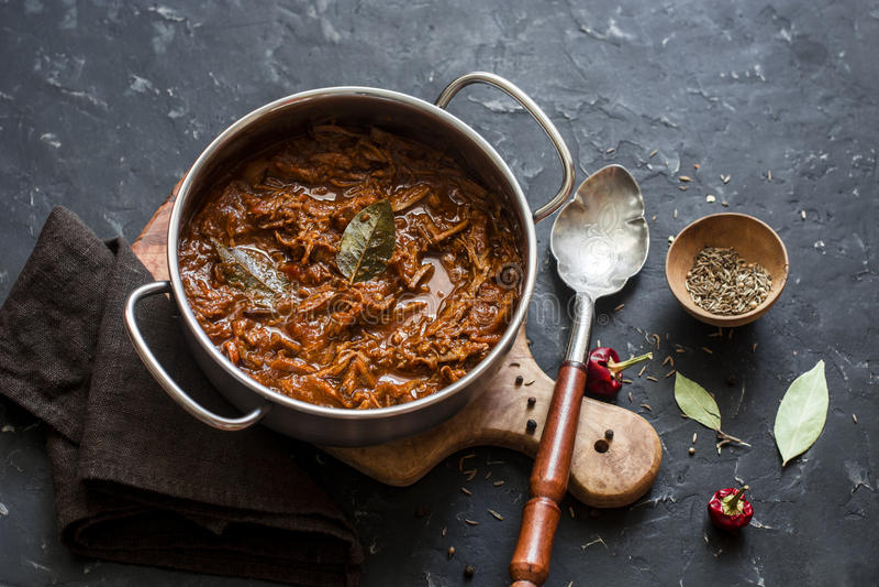 Slow cooker beef ragu. Crock pot braised beef on dark background. Delicious comfort healthy food stock images