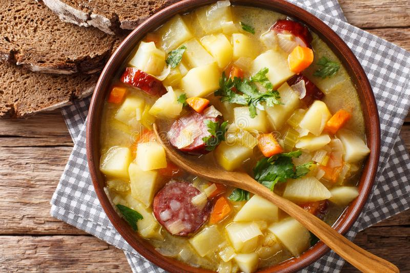 Slow cooker German potato soup kartoffelsuppe close-up on a pl royalty free stock images