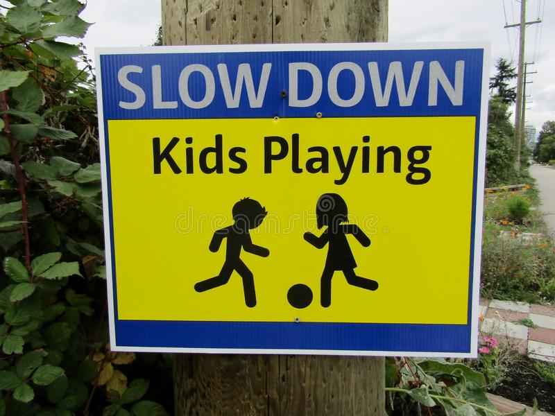 Slow down. Kids playing traffic sign. royalty free stock images