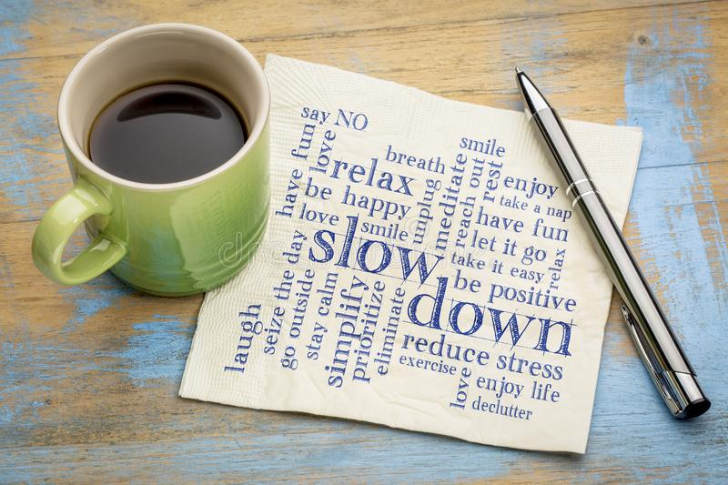 Reducing stress tips word cloud. Slow down and relax - reducing stress tips in a form of a word cloud on a napkin with a cup of coffee royalty free stock image