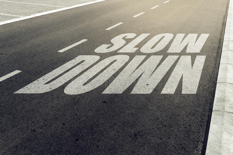 Slow down speed limit sign on highway. Road safety and preventing traffic accident concept royalty free stock image