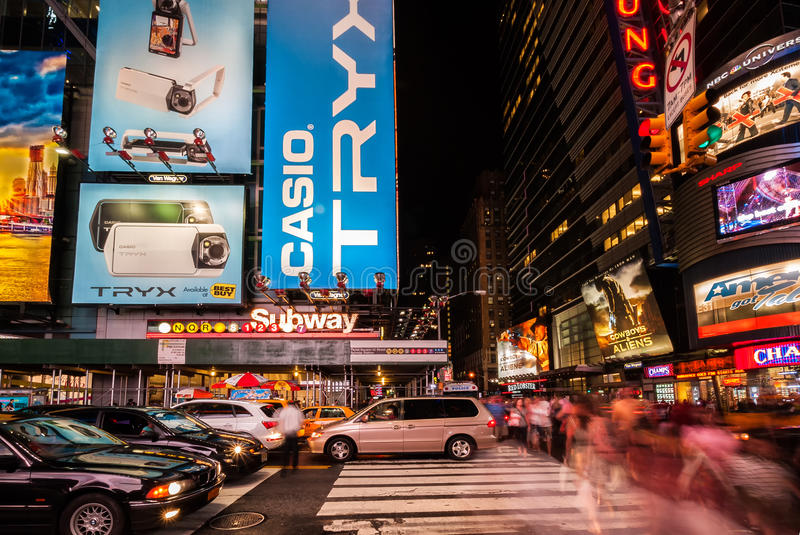 Slow exposure of people and cars passing through Times Square. Times Square, featured with Broadway Theaters and animated LED signs, is a symbol of New York City stock photos