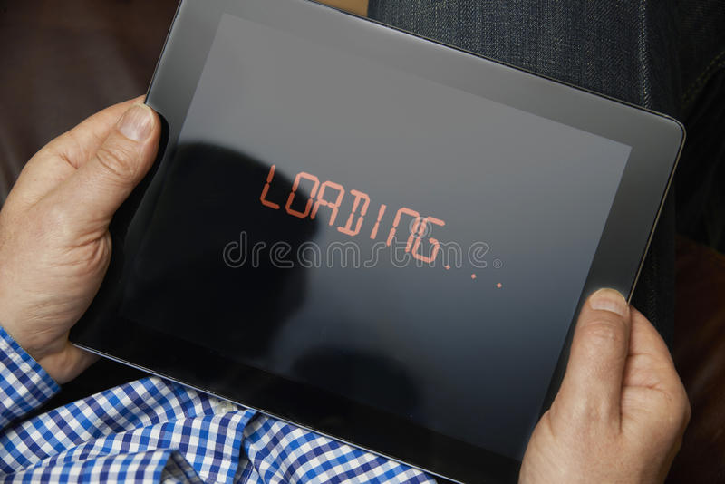 Slow Internet Connection On Digital Tablet. Man With Slow Internet Connection On Digital Tablet royalty free stock image