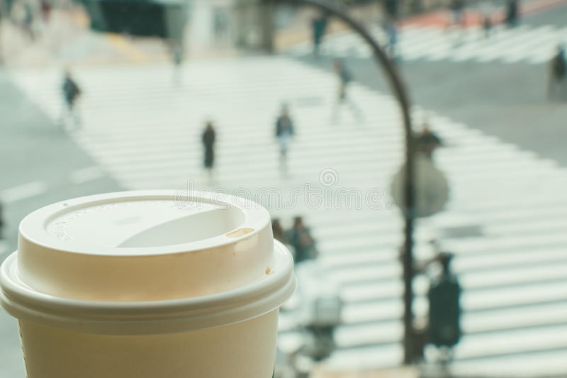 Slow life, Coffee time in rush hour of Big City, blur of people. Slow life, Coffee time in rush hour of Big City with blur of people across pedestrian at Shibuya stock photography