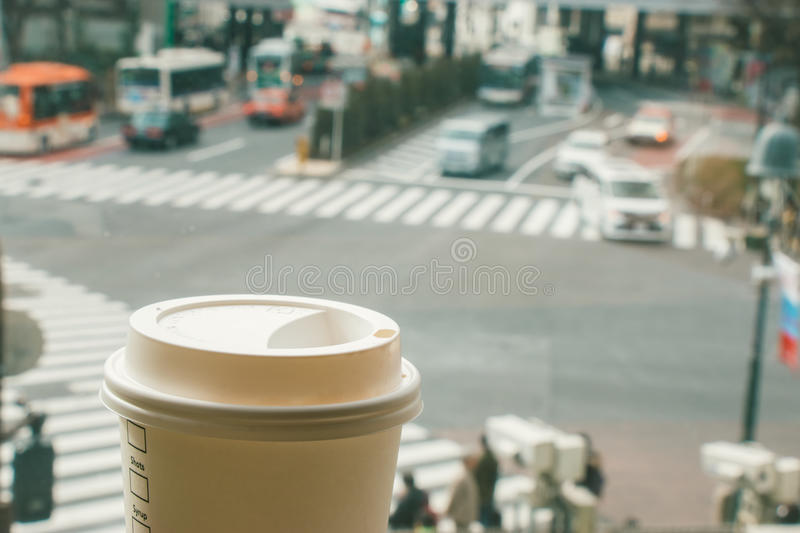 Slow life, Coffee time in rush hour of Big City, blur of people. Slow life, Coffee time in rush hour of Big City with blur of people across pedestrian at Shibuya royalty free stock photos