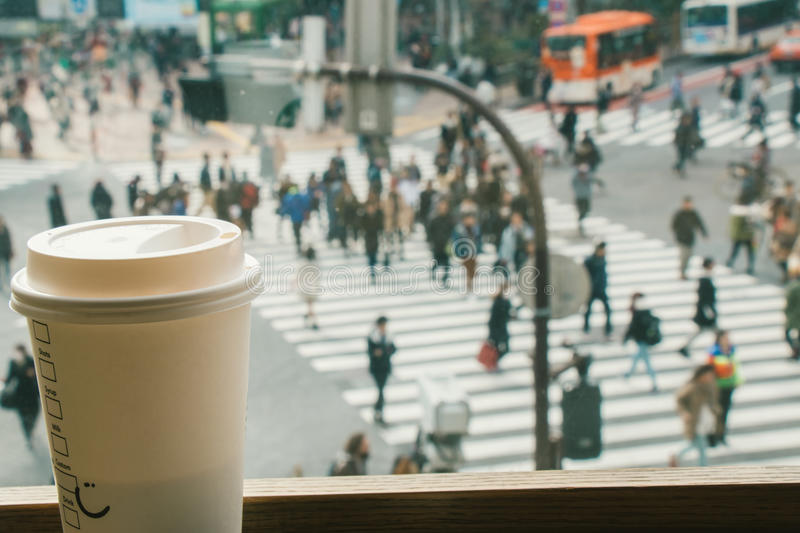 Slow life, Coffee time in rush hour of Big City, blur of people. Slow life, Coffee time in rush hour of Big City with blur of people across pedestrian at Shibuya stock photos
