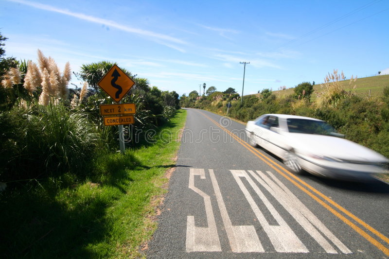 Download Slow Marking On The Road And Fast Car Stock Image - Image: 655477