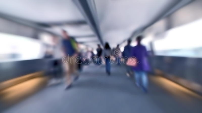 Slow motion video of people moving in crowded tunnel at Hong Kong city street traffic. Blur effect stock video footage