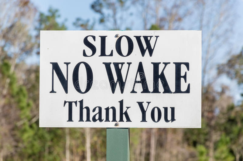 Slow No Wake sign stock images