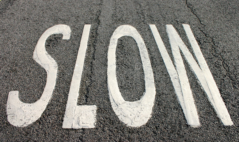 Slow sign on the road royalty free stock photography