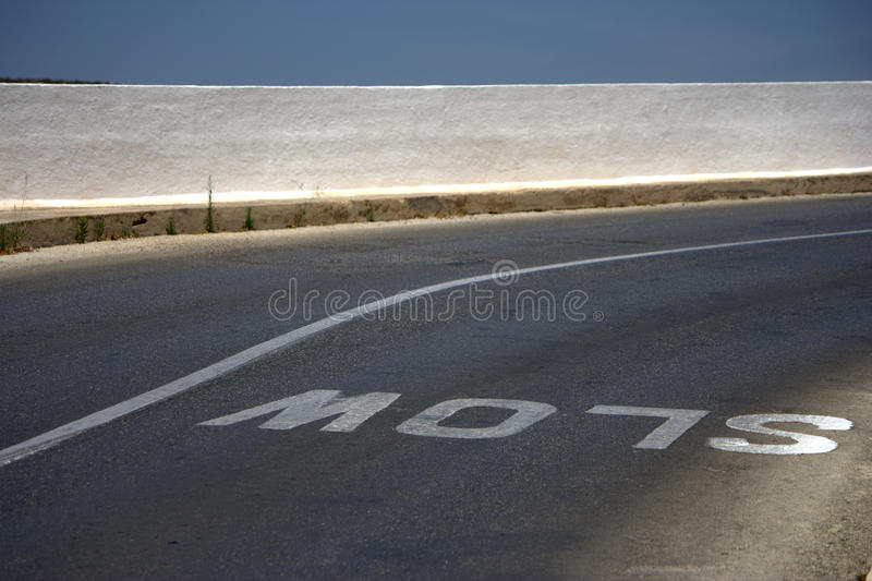 Download Slow sign on the road stock photo. Image of line, bushes - 16499590