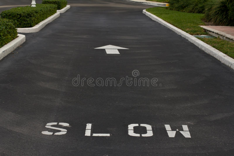 Download Slow sign on the road stock photo. Image of road, black - 17364132