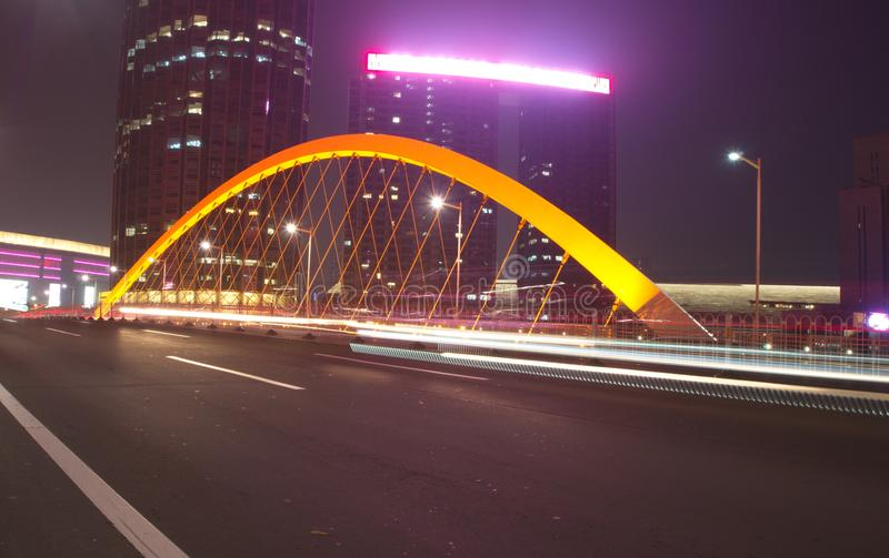 Slow Speed Shutter with the modern bridge in Tianjin City.Travel in Tianjin, China, October 19th, Year 2017. At NIght . Slow Speed Shutter with the modern bridge stock image
