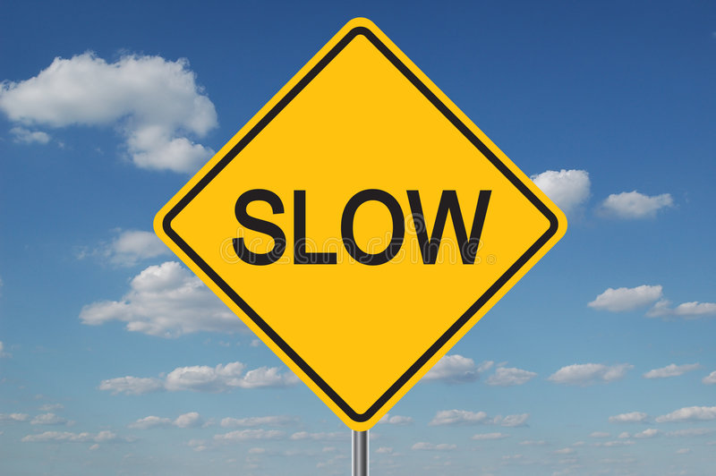 Slow Traffic Sign With Clouds Royalty Free Stock Image