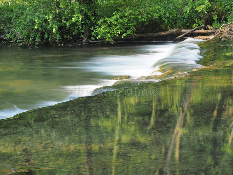Slow water and Monet like reflection royalty free stock photography
