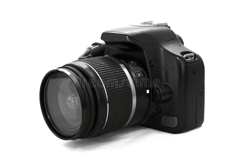SLR camera. Digital SLR camera with attached zoom lens on white royalty free stock photos