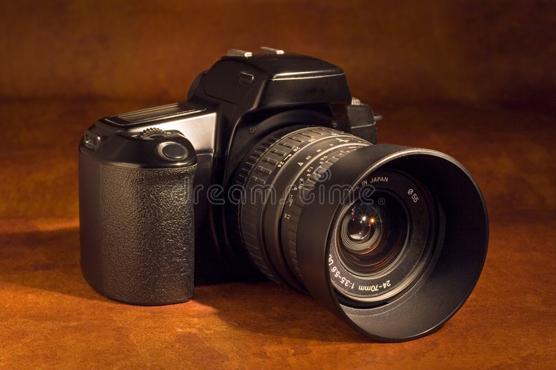 SLR camera. A 35mm SLR camera with standard zoom lens royalty free stock images