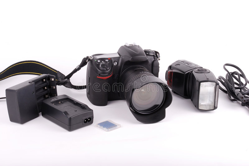 SLR camera. With flash light and accessories on isolated background stock image