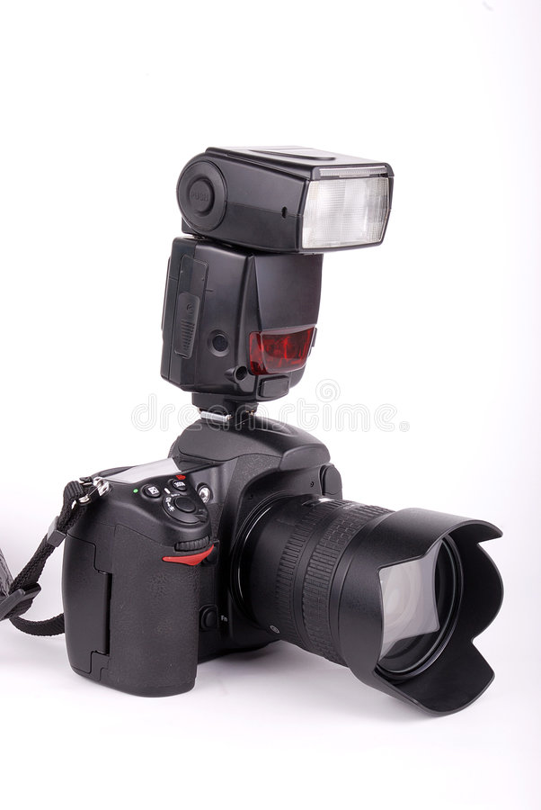 SLR camera. With flash light on isolated background royalty free stock photo