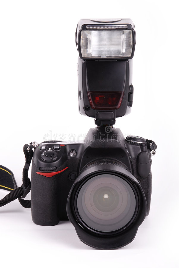 SLR camera. With flash light on isolated background royalty free stock photography