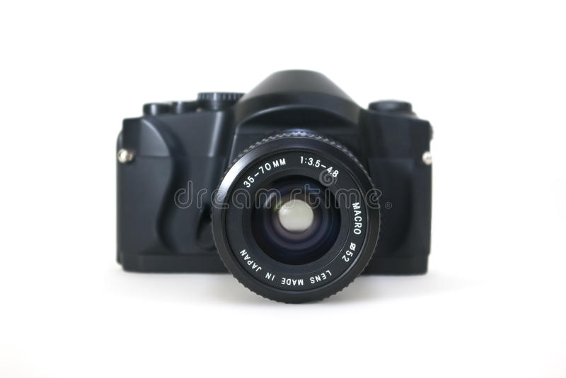 SLR camera with lens. SLR camera with an attached 35-70mm Macro zoom lens shot with a shallow depth of field stock photography