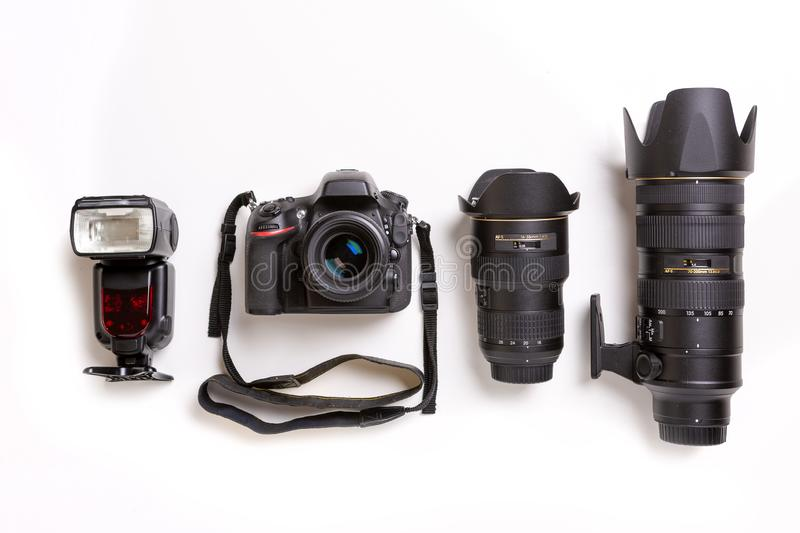 SLR camera, lenses and flash on white background royalty free stock images
