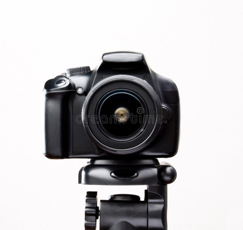 SLR camera on a tripod close-up stock image