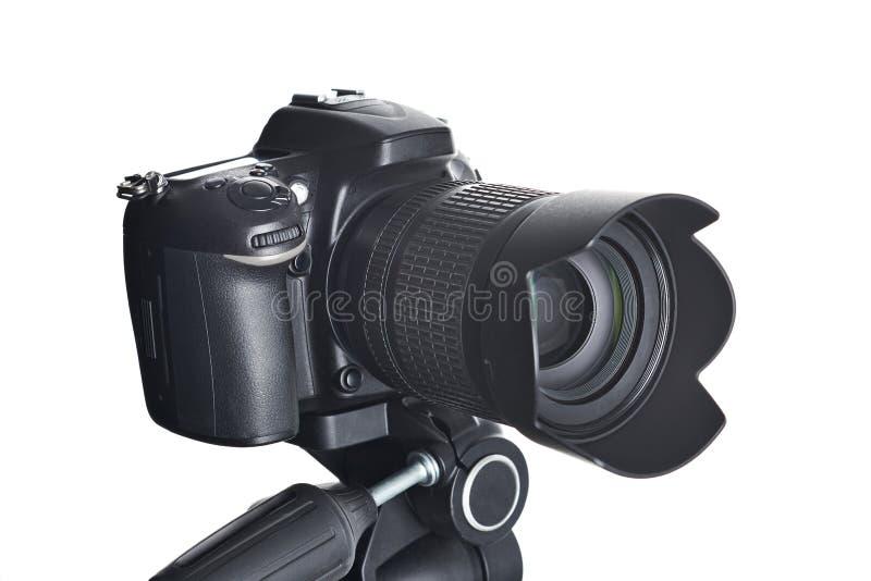 SLR camera on tripod isolated on white stock photography