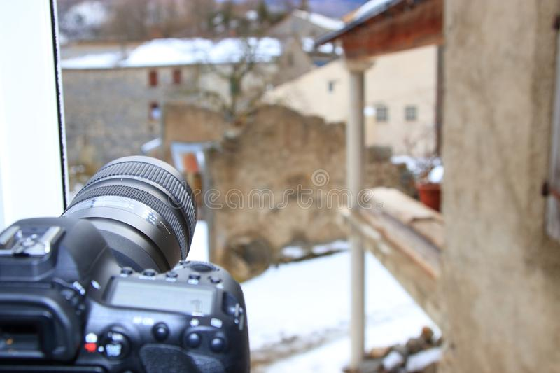 SLR camera on a tripod taking pictures of french village stock images
