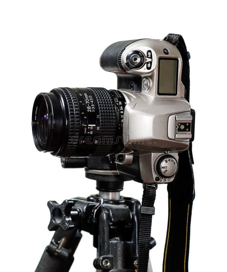 Slr/dslr camera mounted on tripod stock photography