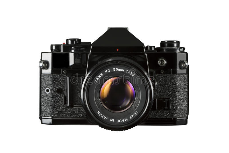 SLR 35mm film camera. A 1980 SLR film camera isolated on white background royalty free stock image