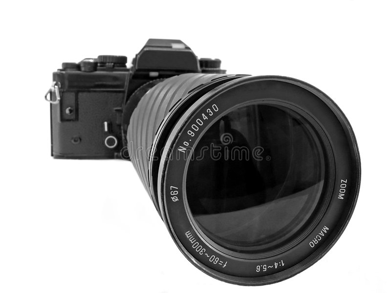 SLR with zoom. A 35mm SLR camera with zoom lens fitted isolated from background royalty free stock photos