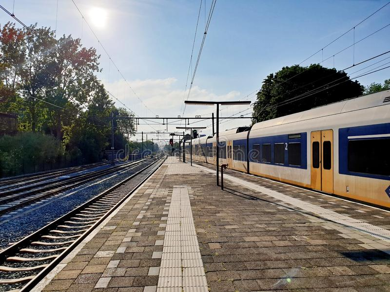 SLT local commuter leaving the station of Gouda in the morning. royalty free stock image