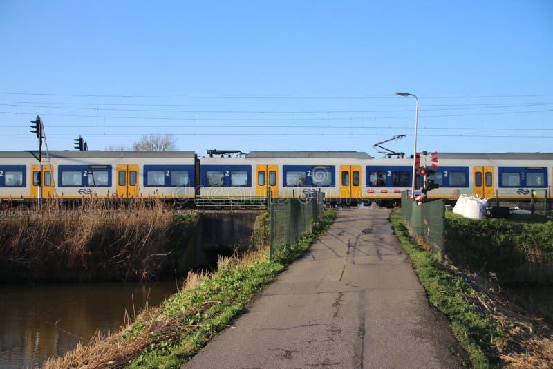 SLT local commuter train at a railroad crossway at nieuwerkerk aan den IJssel in the Netherlands stock image